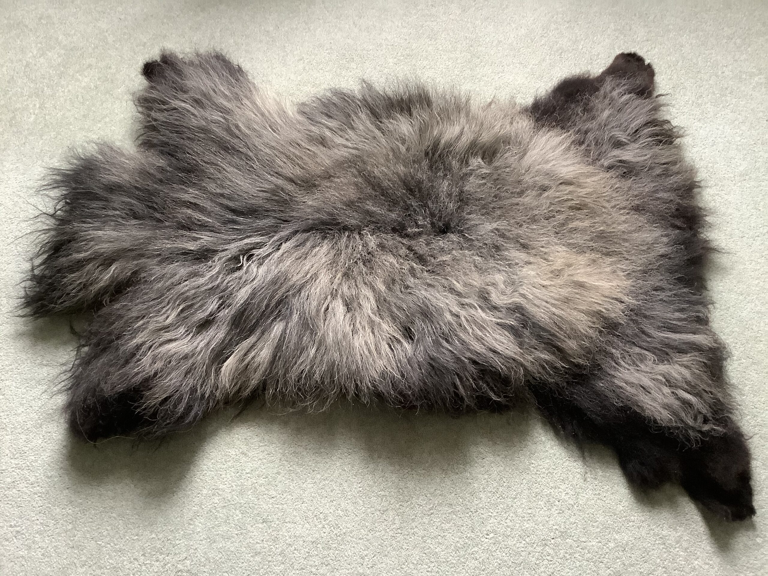 Grey sheep skin rug